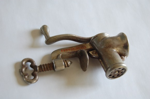 Photograph 10. Meat grinder, accession number visible.